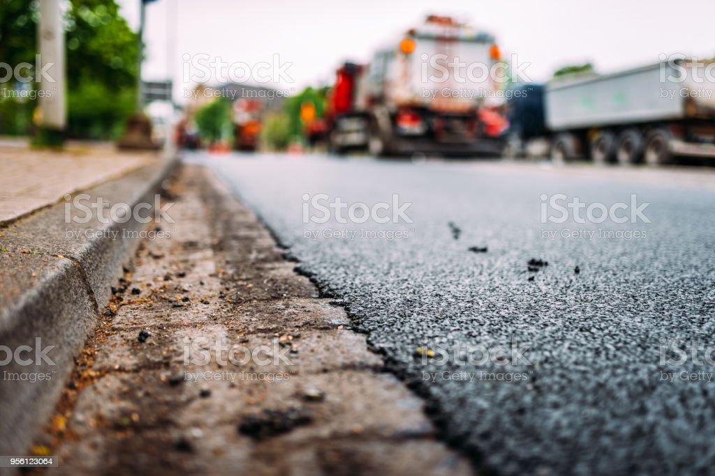 Fresh asphalt close-up. Road repair work.