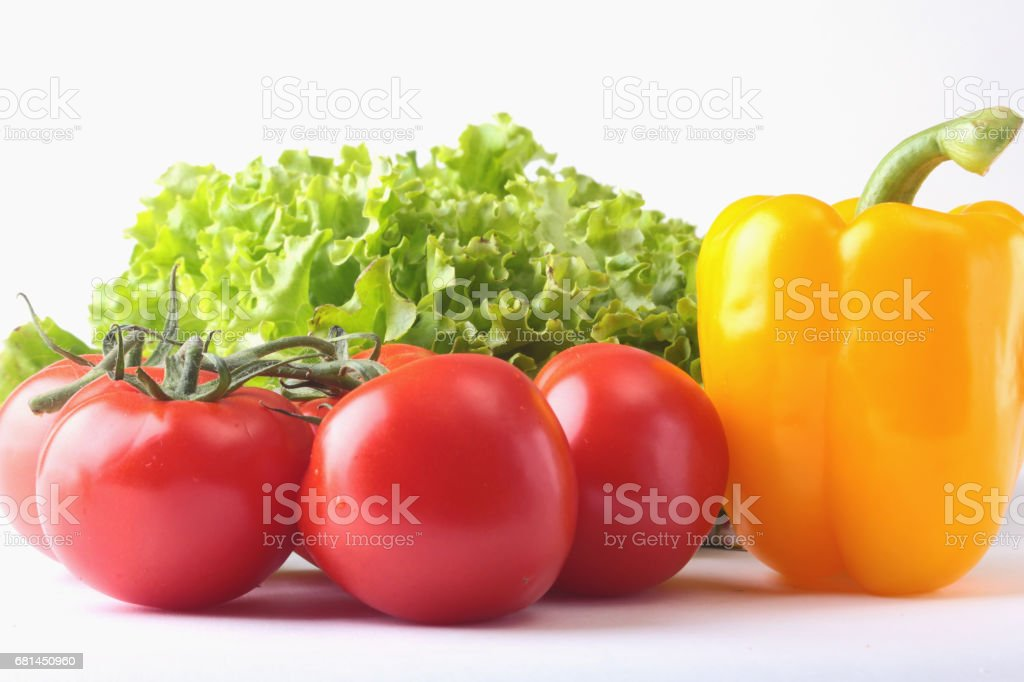 Fresh assorted vegetables bell pepper, tomato, garlic with leaf lettuce. Isolated on white background. Selective focus. royalty-free stock photo