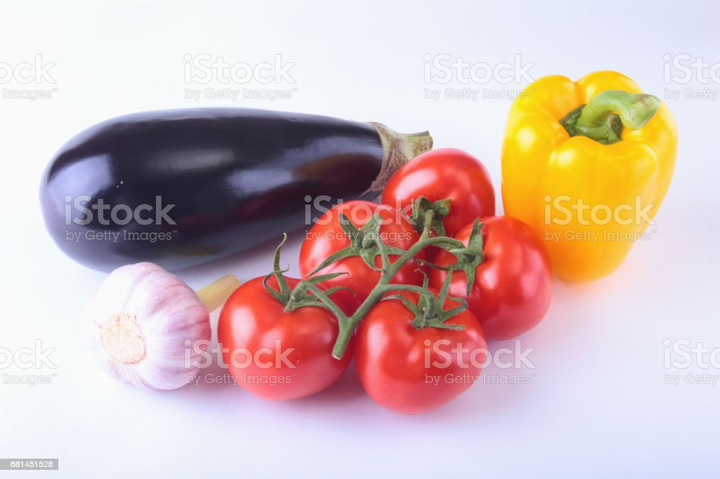 Fresh assorted vegetables eggplant, bell pepper, tomato, garlic. Isolated on white background. Selective focus. royalty-free stock photo