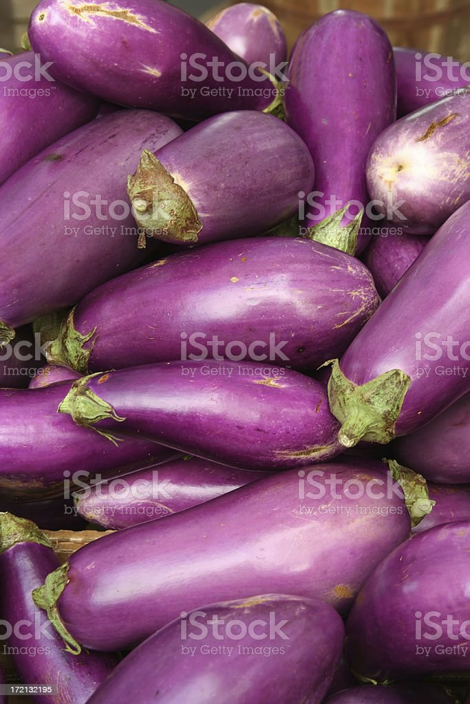 Fresh Aubergine Egg Plant on Market Stall royalty-free stock photo