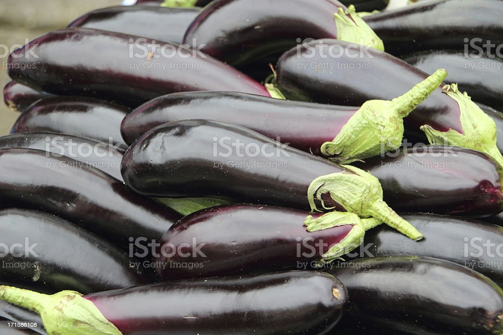 fresh aubergines on the market royalty-free stock photo