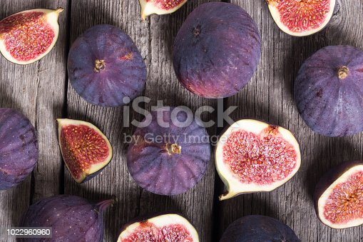 Fresh autumn fruit figs . Healthy food on rustic background