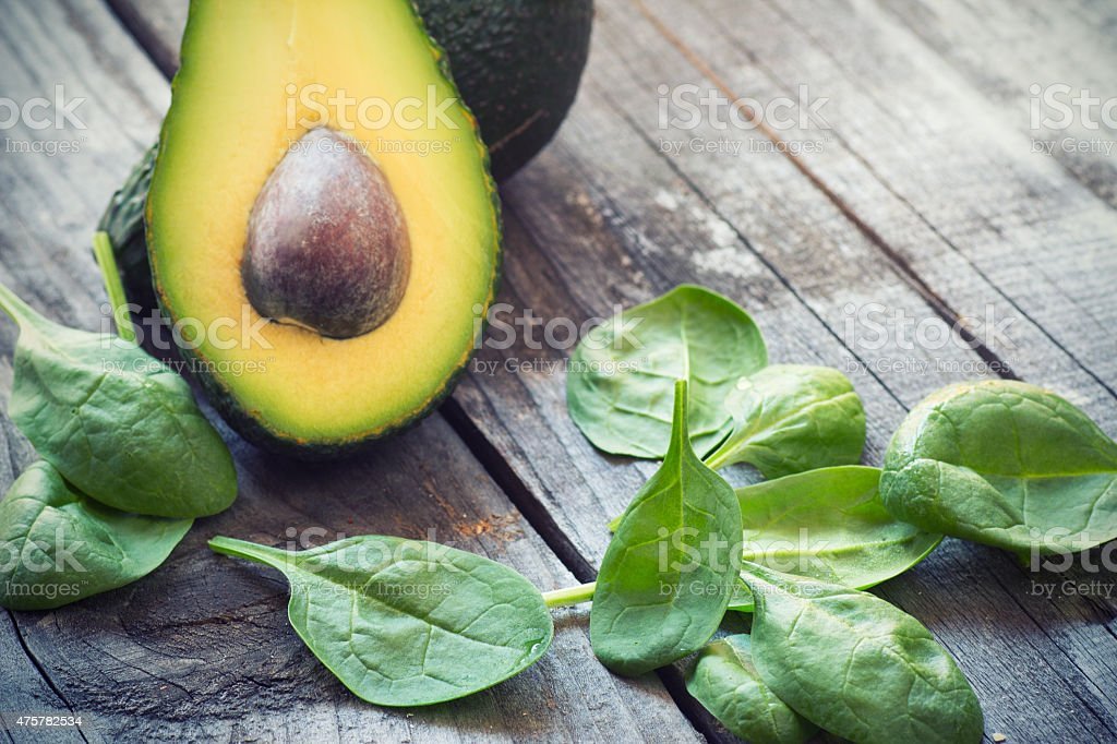 fresh  avocado and baby spinach stock photo