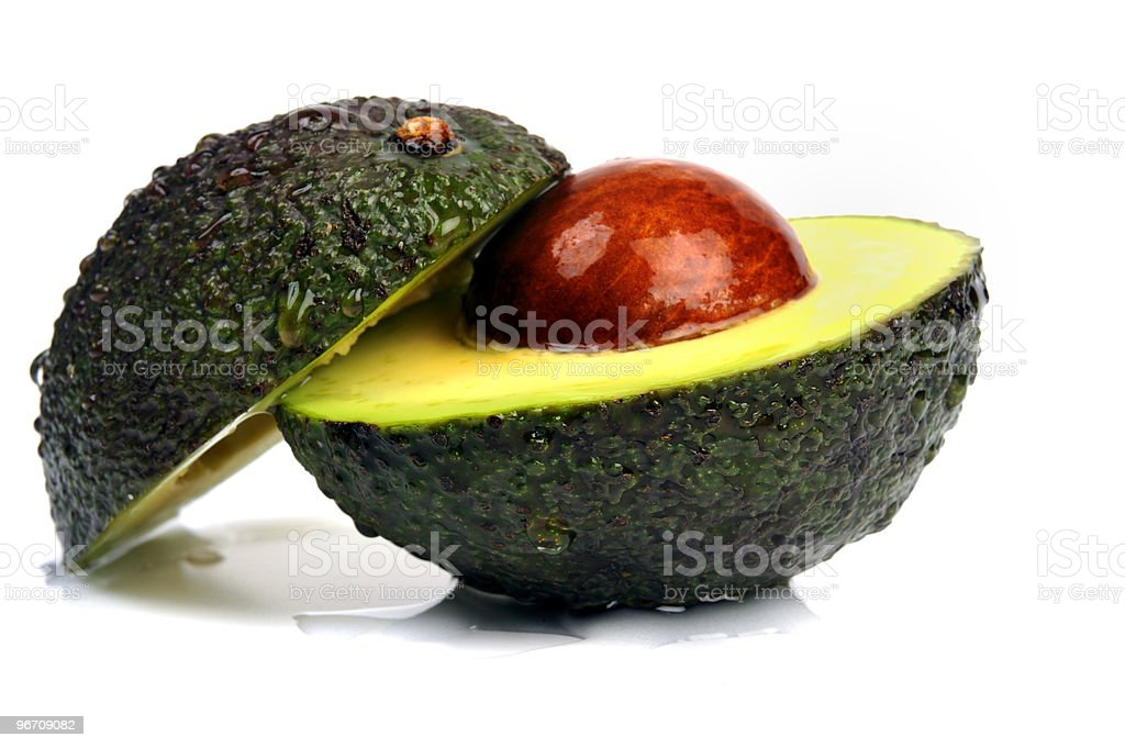 Fresh avocado cut in half showing seed / core royalty-free stock photo