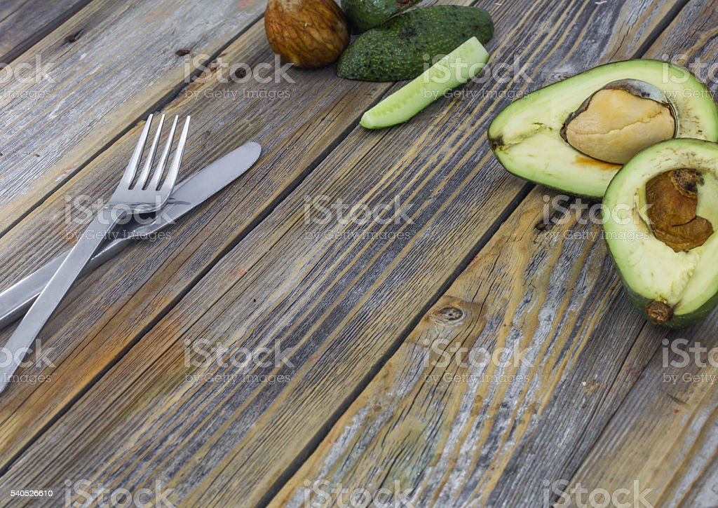 fresh avocado cut on wooden background stock photo