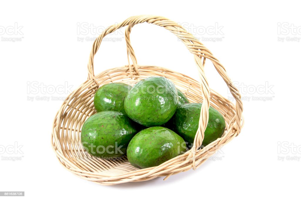 Fresh avocado in rattan basket isolated on white background stock photo