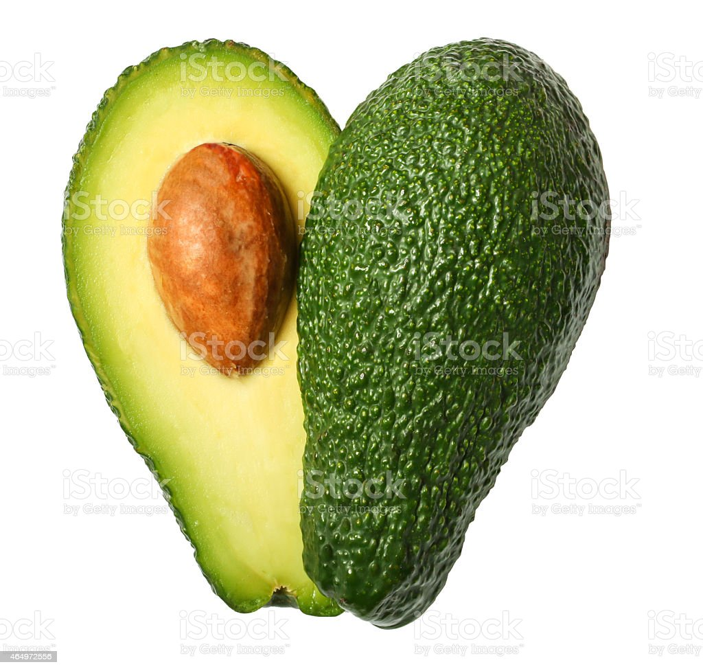 Fresh avocado in the shape of a heart stock photo