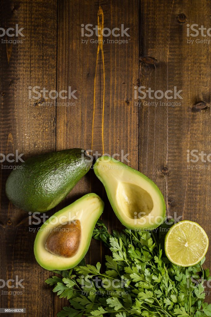 Fresh Avocado on Dark Wood Background. Healthy Food Concept. royalty-free stock photo