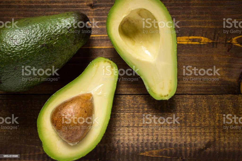 Fresh Avocado on Dark Wood Background. Healthy Food Concept. zbiór zdjęć royalty-free