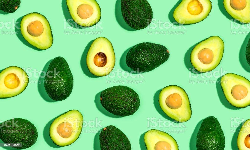 Fresh avocado pattern on a green background stock photo
