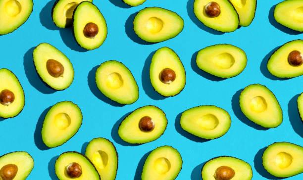 fresh avocado pattern - avocado foto e immagini stock