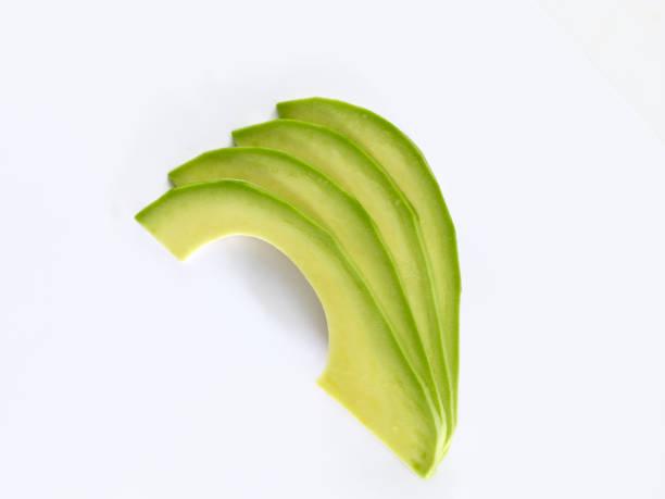 fresh avocado slices stock photo