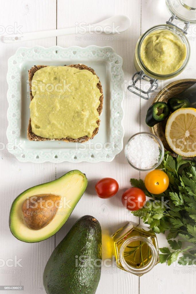 Fresh Avocado Spread Guacamole as Healthy Breakfast Food Concept zbiór zdjęć royalty-free