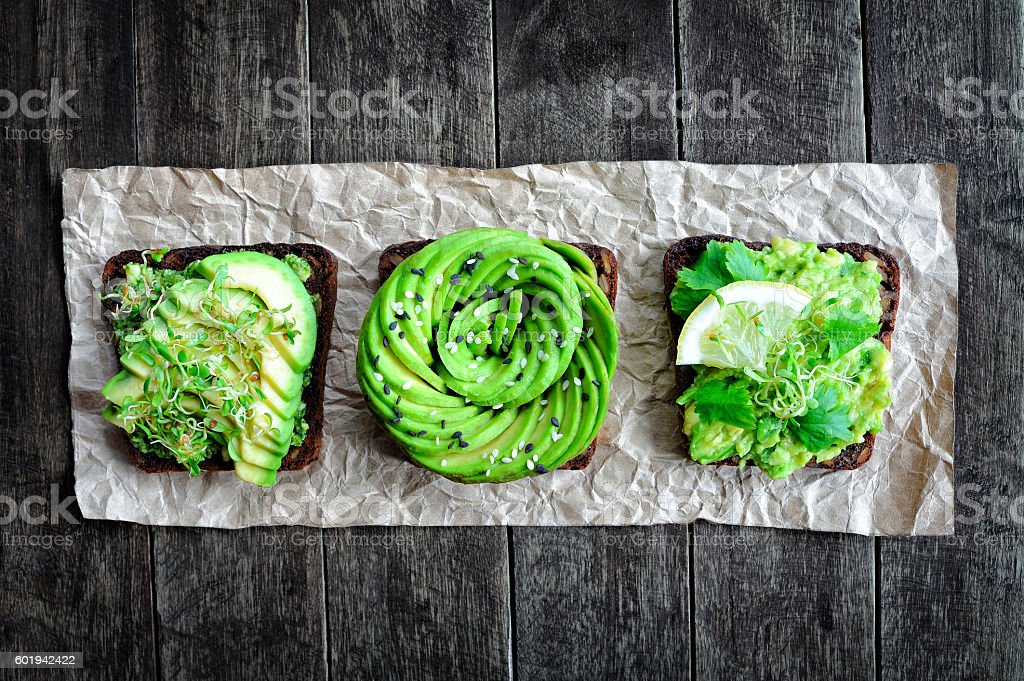 Fresh avocado toasts stock photo