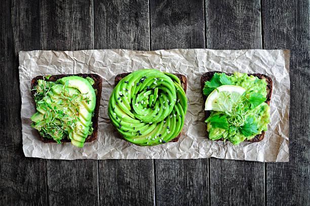 Fresh avocado toasts stock photo