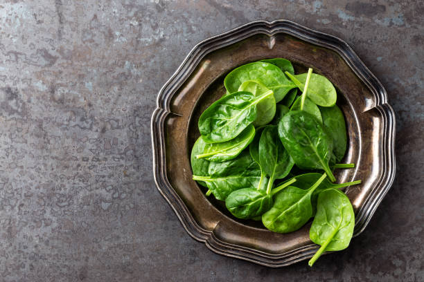 Fresh baby spinach leaves stock photo