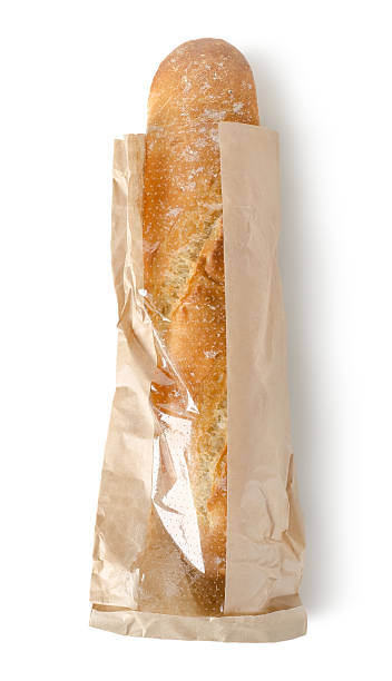 Fresh baguette in a paper bag stock photo