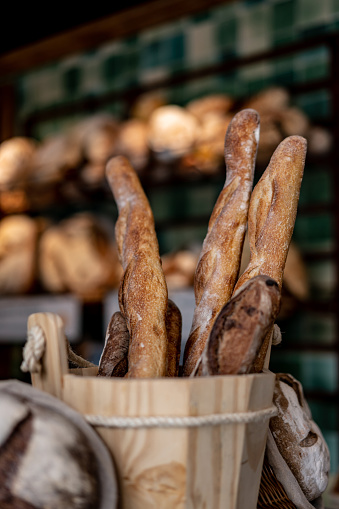 Fresh baguettes at a bakery shop - food and drinks concepts