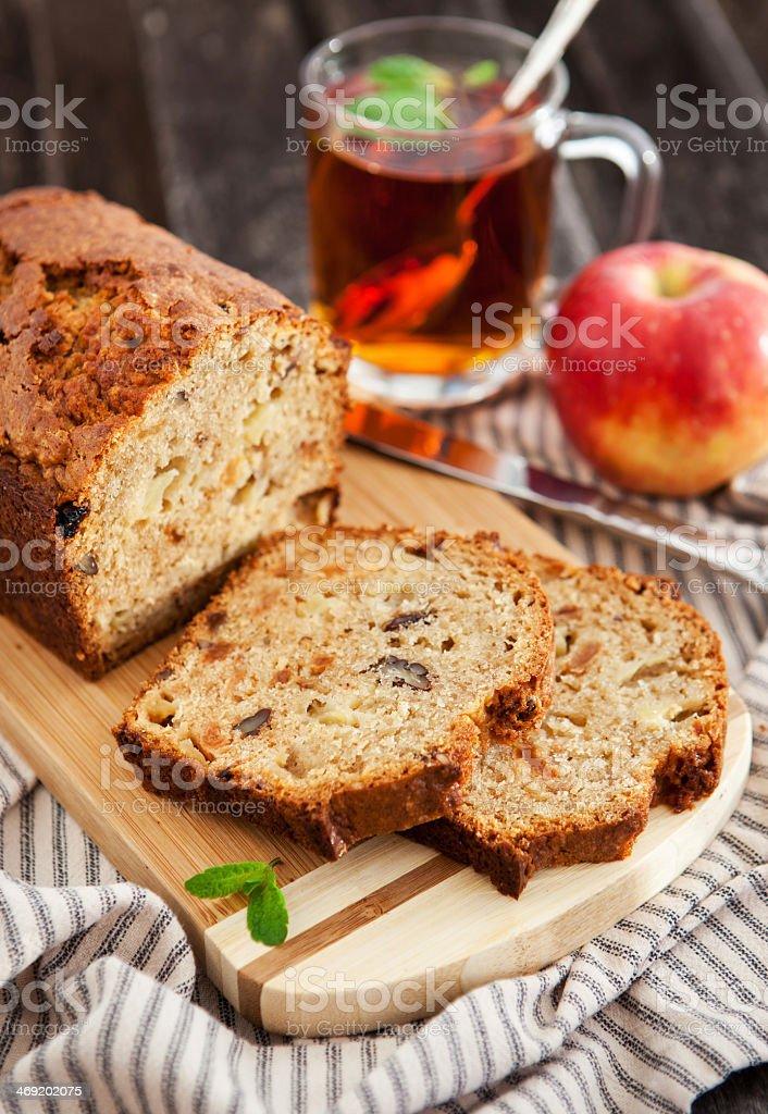Fresh baked apple nut bread on wooden cutting board stock photo