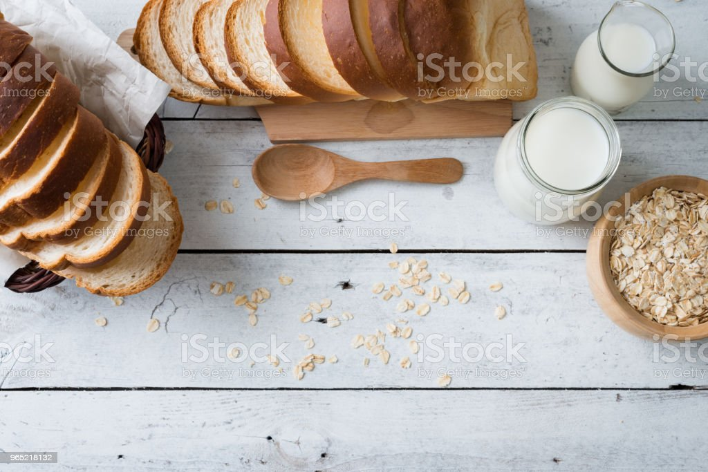 Fresh baked bread and sliced bread on rustic wooden table royalty-free stock photo