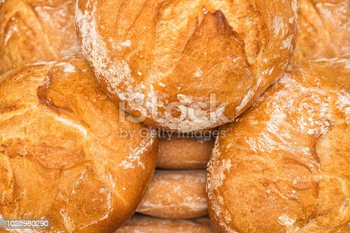 istock Fresh baked bread background 1025980290