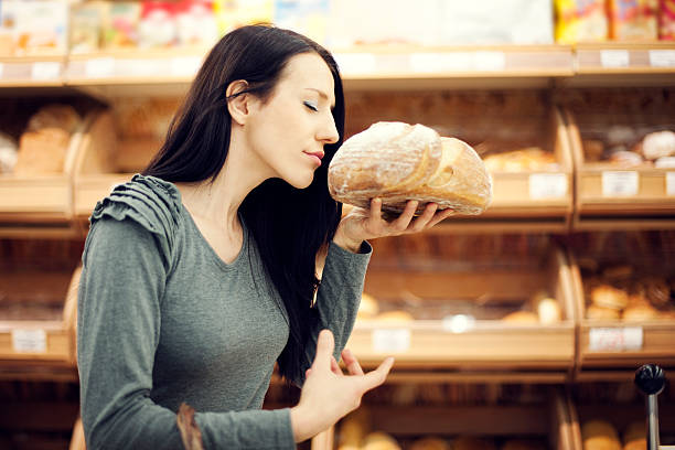 fresh baked bread - food woman to smell bildbanksfoton och bilder