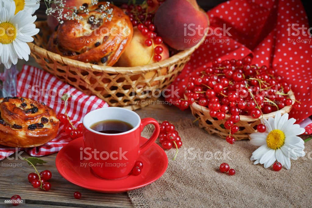 Fresh baked buns with a cup of coffee royalty-free stock photo