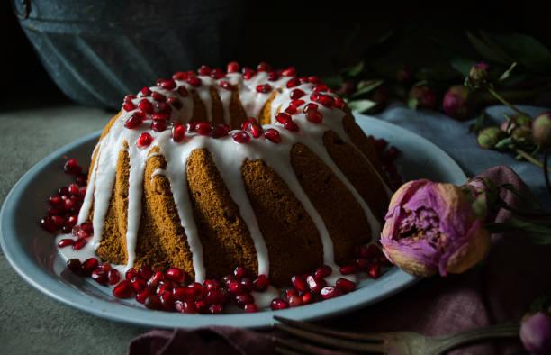 Fresh baked cake with white icing stock photo