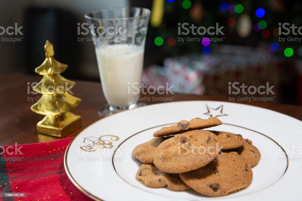 Fresh baked chocolate chip cookies and milk with holiday theme stock photo