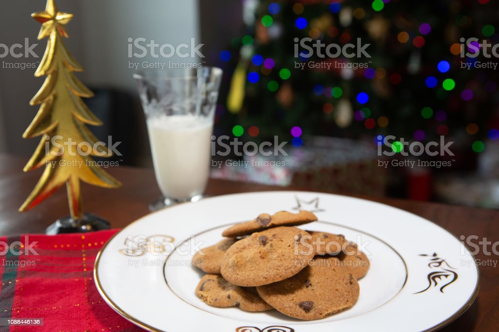 Fresh baked chocolate chip cookies with holiday decorations. stock photo