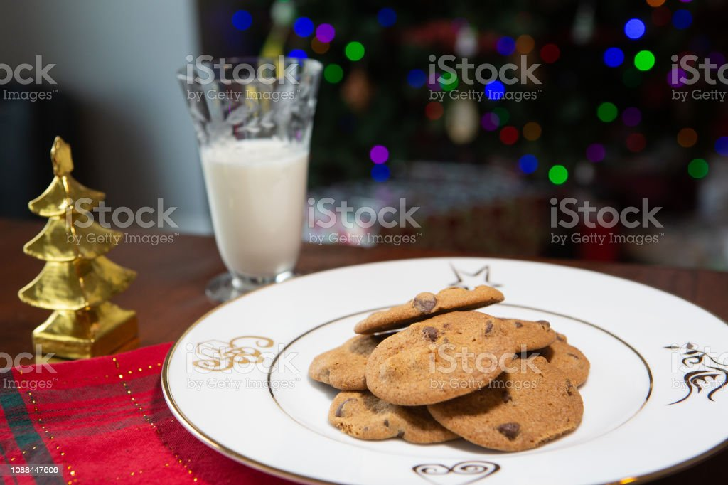Fresh baked chocolate chip cookies with holiday decorations stock photo