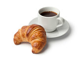 Fresh baked croissant and a cup of coffee