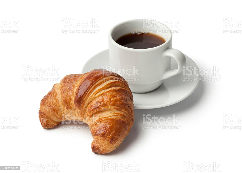 Fresh baked croissant and a cup of coffee - foto stock