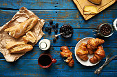 Fresh baked croissants and baguette, blackberry jam