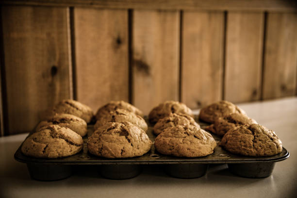 Fresh Baked Homemade Apple Pumpkin Cinnamon Oat Muffins in Tin stock photo