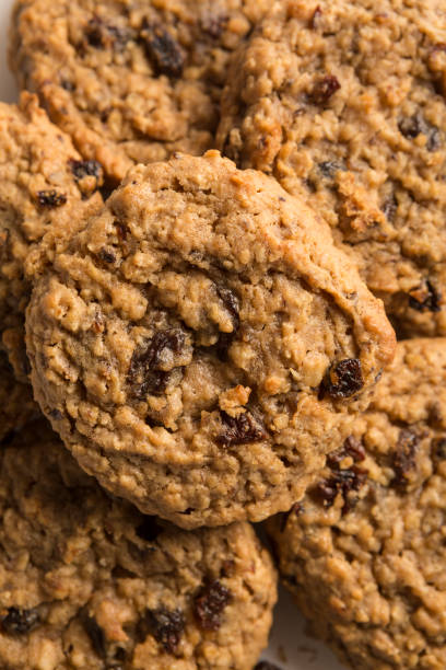 Fresh baked, Mouth watering Stacked oatmeal raisin cookies background. Sweet biscuits. Homemade sweetness stock photo