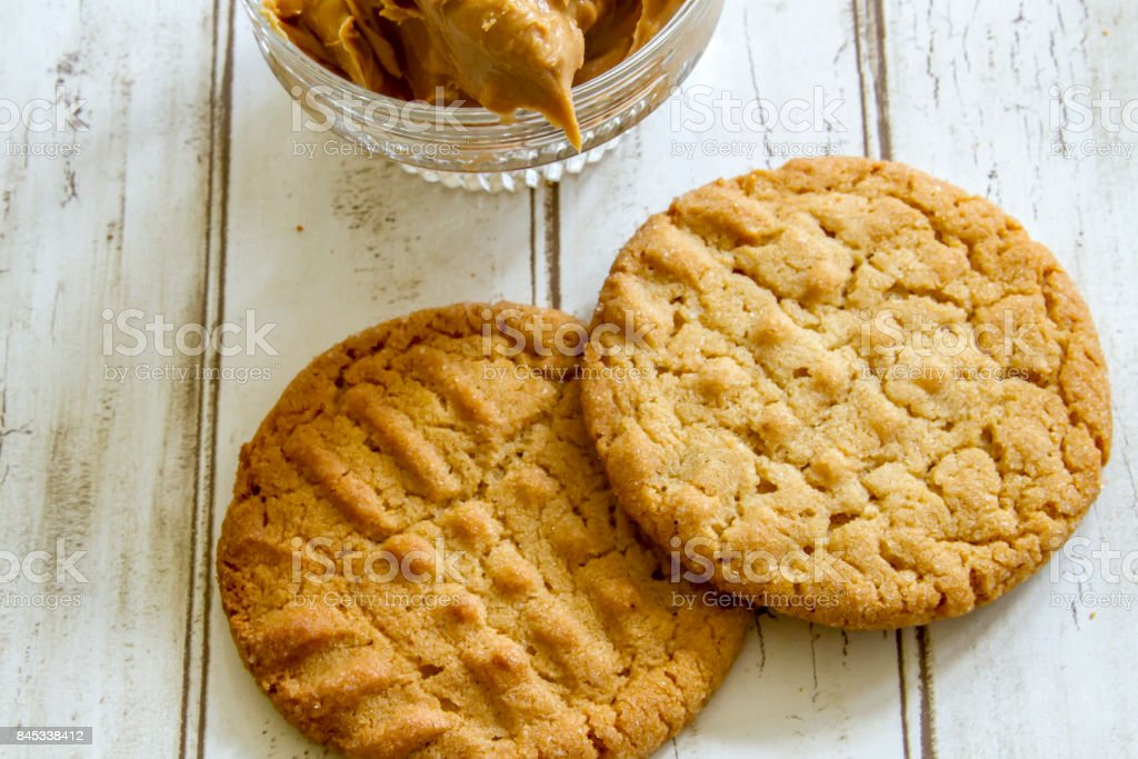 Fresh baked peanut butter cookies with peanut butter stock photo