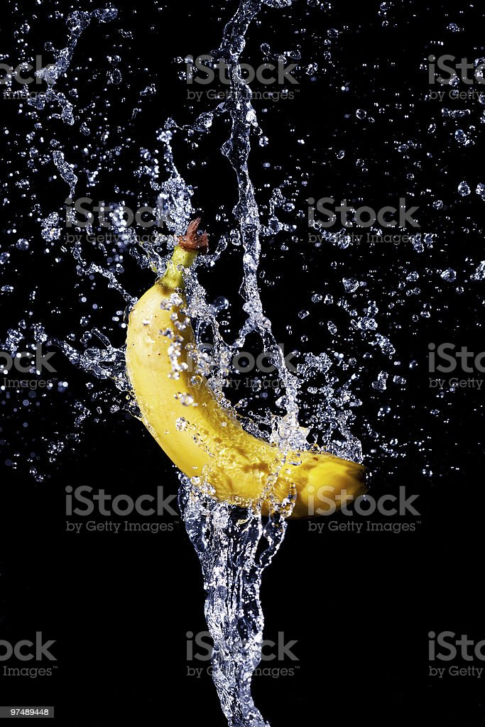 fresh banana gets hit by a water stream royalty-free stock photo