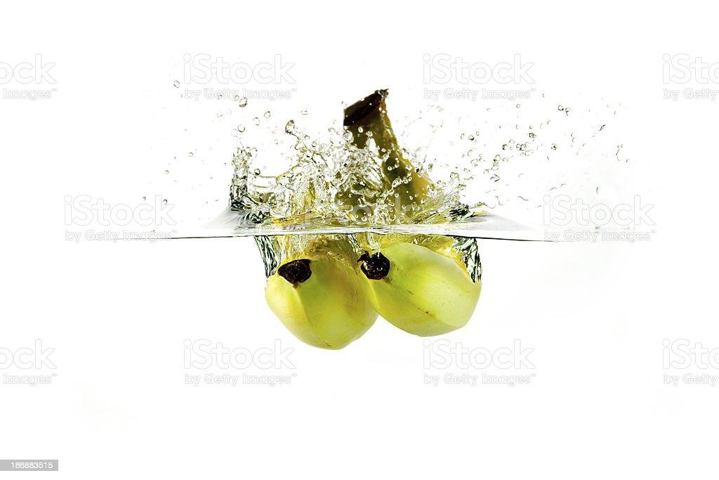Fresh banana water splash stock photo