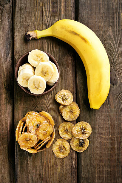 Fresh bananas and chips stock photo