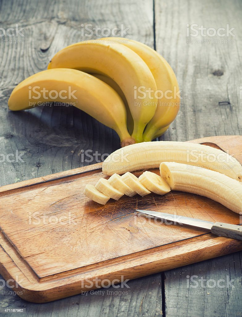 Fresh bananas on wooden background stock photo