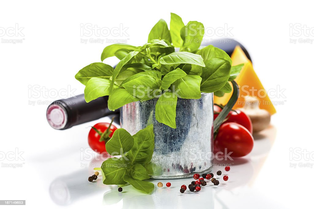 Fresh basil in the pot and italian ingredients royalty-free stock photo
