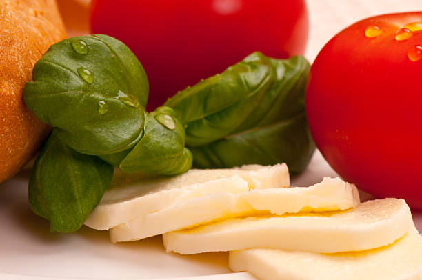 Fresh basil with tomatoes, Mozzarella cheese and bread stock photo