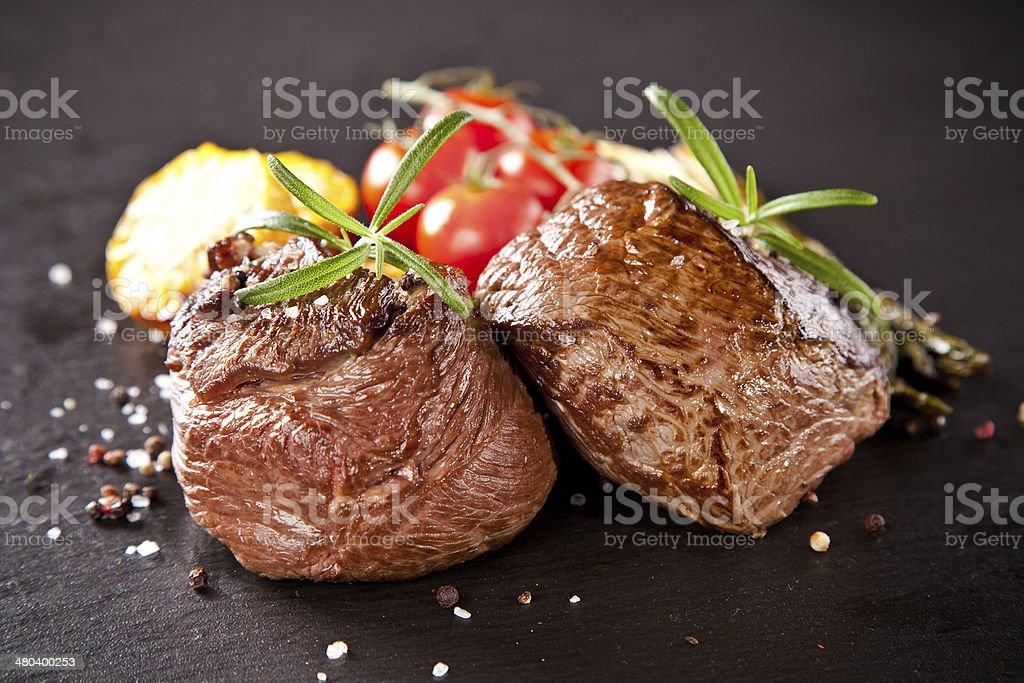 Fresh beef steak on black stone stock photo