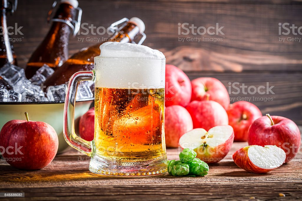 Fresh beer made from red apples stock photo