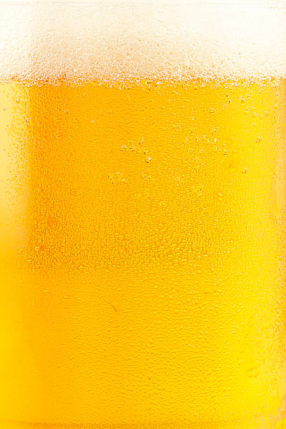 Fresh Beer Macro shot of blonde beer in glass  lager stock pictures, royalty-free photos & images