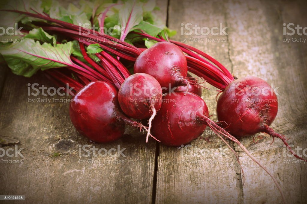 Fresh beetroot i on rustic wooden background. Harvest vegetable cooking conception . Diet or vegetarian food concept stock photo