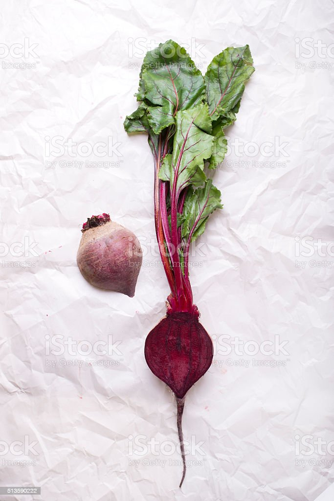 fresh beetroot in half, isolated on a paper background stock photo