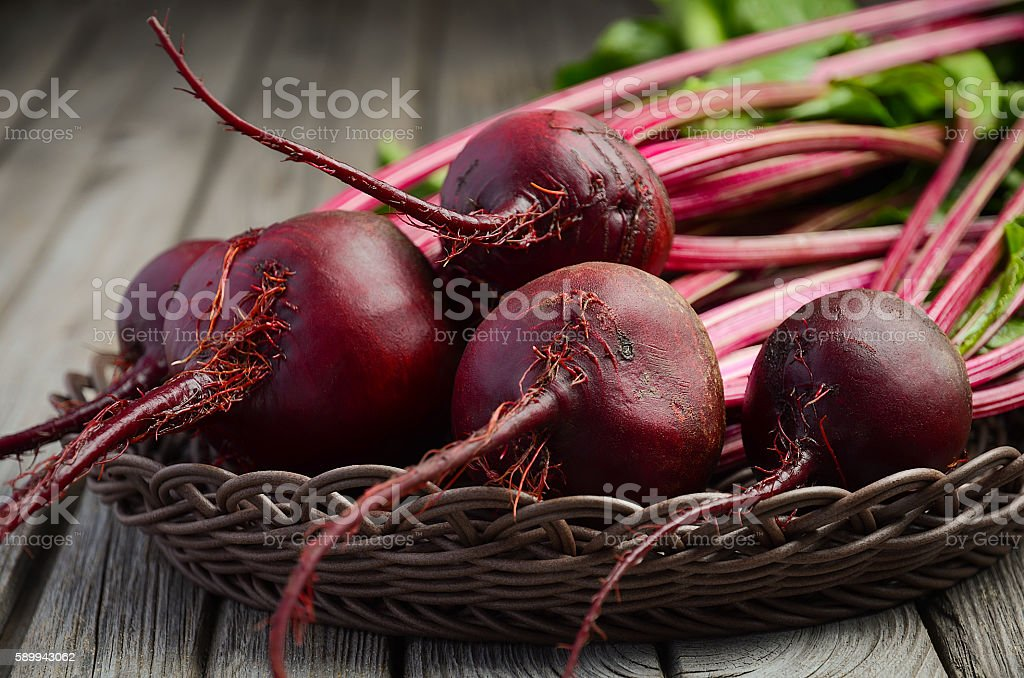 Fresh beets on wooden background stock photo