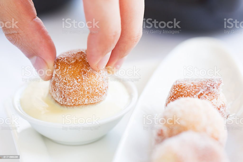 fresh beignets with sauce stock photo